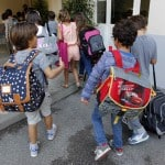 Schoolchildren walk to enter a class in a primary school in Marseille